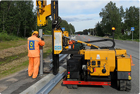 Erection of road and bridge barriers